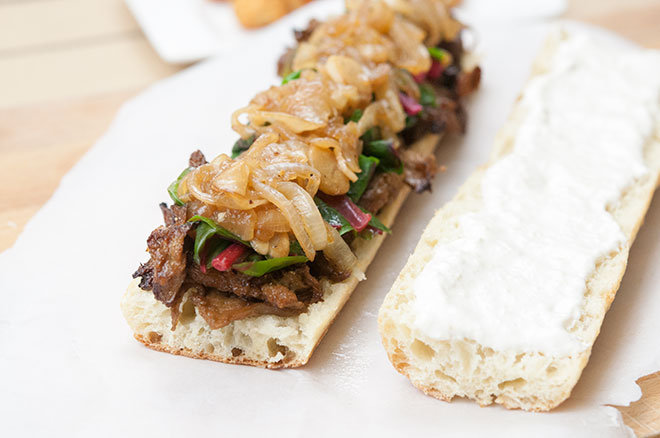 Maple Glazed Seitan Sandwich, w/ Beer Braised Onions & Garlic, Swiss Chard, & Horseradish Cream